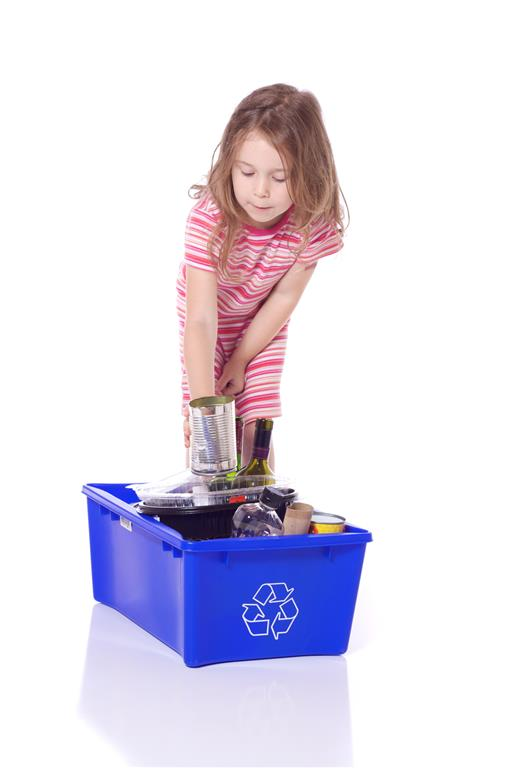 Cute little girl recycling a can